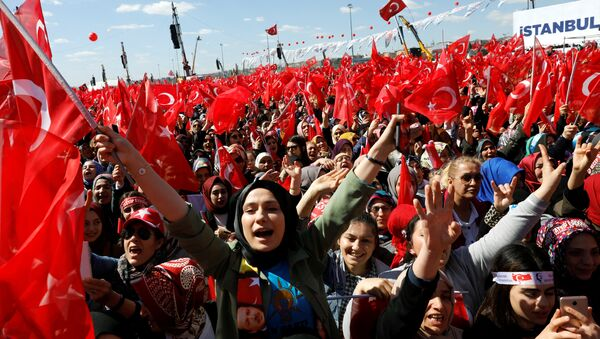 Turkish President Tayyip Erdogan's supporters are seen ahead of a rally for the upcoming local elections, in Istanbul, Turkey March 24, 2019. - Sputnik International