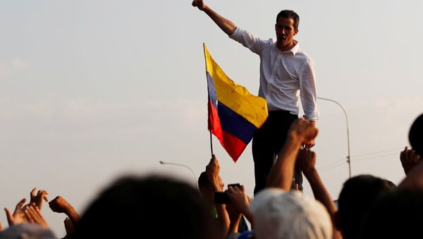 Venezuelan opposition leader Juan Guaido, who many nations have recognized as the country's rightful interim ruler, attends a rally in San Mateo Anzoategui, Venezuela March 22, 2019 - Sputnik International