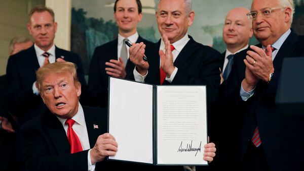 U.S. President Donald Trump holds a proclamation recognizing Israel's sovereignty over the Golan Heights as he is applauded by Israel's Prime Minister Benjamin Netanyahu and others during a ceremony in the Diplomatic Reception Room at the White House in Washington, U.S., March 25, 2019 - Sputnik International