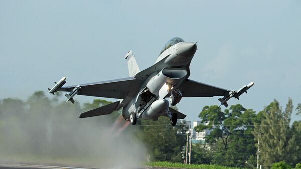In this Sept. 16, 2014, file photo, a Taiwan Air Force F-16 fighter jet takes off from a closed section of highway during the annual Han Kuang military exercises in Chiayi, central Taiwan - Sputnik International
