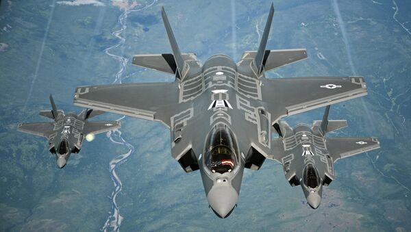 F-35A Lightning II aircraft receive fuel from a KC-10 Extender from Travis Air Force Base, Calif., July 13, 2015, during a flight from England to the U.S. The fighters were returning to Luke AFB, Ariz., after participating in the world's largest air show, the Royal International Air Tattoo. - Sputnik International