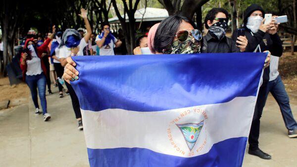 Masked demonstrators take part in a protest against Nicaraguan President Daniel Ortega's government - Sputnik International
