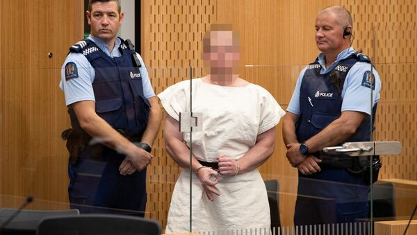 Brenton Tarrant, charged for murder, making a sign to the camera during his appearance in the Christchurch District Court, New Zealand March 16, 2019 - Sputnik International