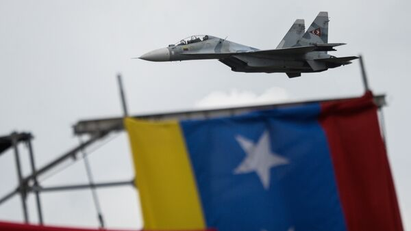Russian-made Venezuelan Air Force Sukhoi Su-30MKV multirole strike fighters overfly a military parade to celebrate Venezuela's 206th anniversary of its Independence in Caracas on July 5, 2017 - Sputnik International