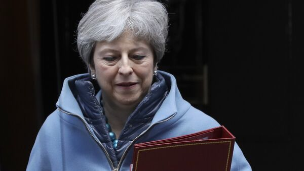 Britain's Prime Minister Theresa May leaves 10 Downing Street in London, Monday, March 25, 2019 - Sputnik International