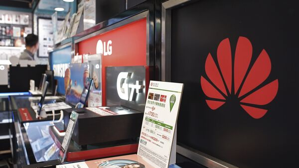 A logo of Huawei is displayed at a electronic retail shop in Hong Kong, Friday, March 29, 2019. Chinese tech giant Huawei's deputy chairman defended its commitment to security Friday after a stinging British government report added to Western pressure on the company by accusing it of failing to repair dangerous flaws in its telecom technology. - Sputnik International