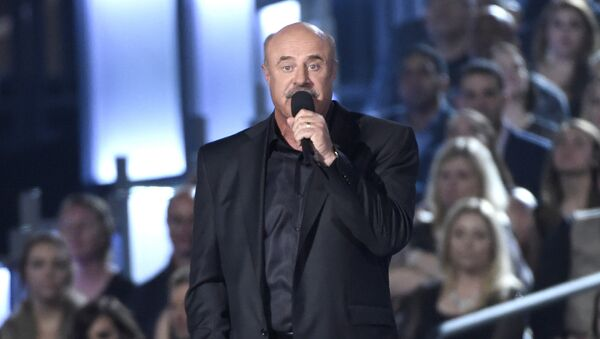 Dr. Phil McGraw speaks on stage at the 50th annual Academy of Country Music Awards at AT&T Stadium on Sunday, April 19, 2015, in Arlington, Texas. - Sputnik International