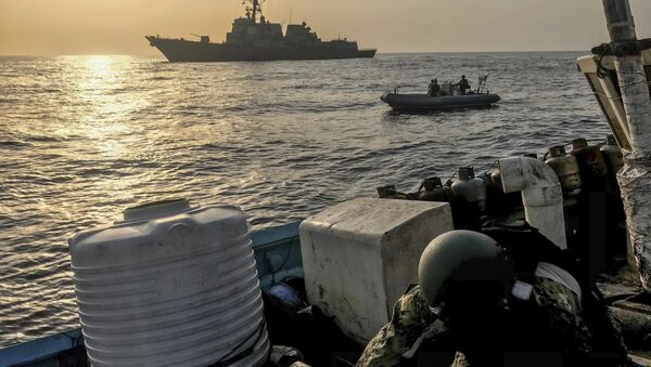 Aug. 30, 2018, a team from the guided-missile destroyer USS Jason Dunham inspects a dhow while conducting maritime security operations - Sputnik International