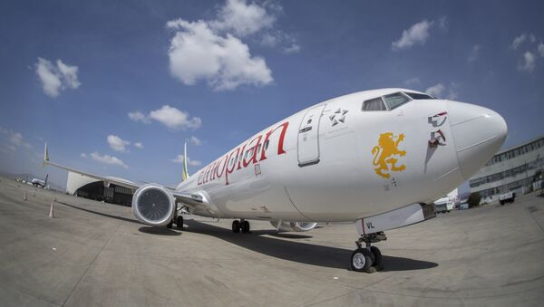 An Ethiopian Airlines Boeing 737 Max 8 sits grounded at Bole International Airport in Addis Ababa, Ethiopia Saturday, March 23, 2019 - Sputnik International