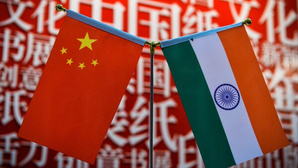 The national flags of India (R) and China are seen at the Delhi World Book fair at Pragati Maidan in New Delhi on January 9, 2016 - Sputnik International