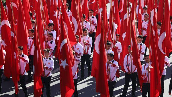 Students hold Turkish flags prior to a ceremony at the mausoleum of Turkey's founder Mustafa Kemal Ataturk on Republic Day in Ankara, Turkey, Monday, Oct. 29, 2018 - Sputnik International