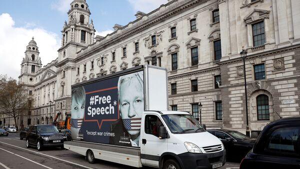 A truck carrying a poster relating to WikiLeaks founder Julian Assange, who has been living at Ecuador's embassy in London, drives through London, Britain April 3, 2019 - Sputnik International