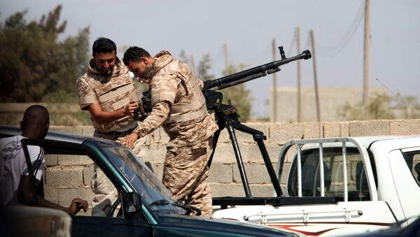 Soldiers from the Libyan National Army get ready to enter Rafallah al-sahati Islamic Militia Brigades compound, one of the compound buildings can be seen behind the wall, in Benghazi, Libya, Saturday, Sept. 22, 2012.  - Sputnik International