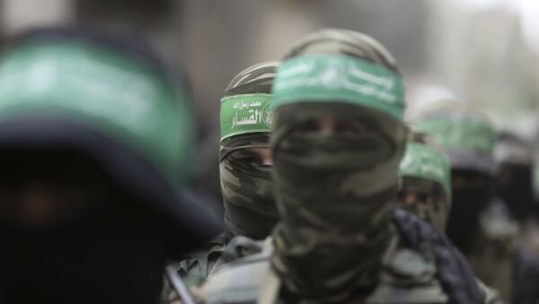 Masked Palestinian Hamas gunmen attend a funeral for six of their fighters who were killed in an explosion Saturday, in Deir el-Balah, central Gaza Strip - Sputnik International
