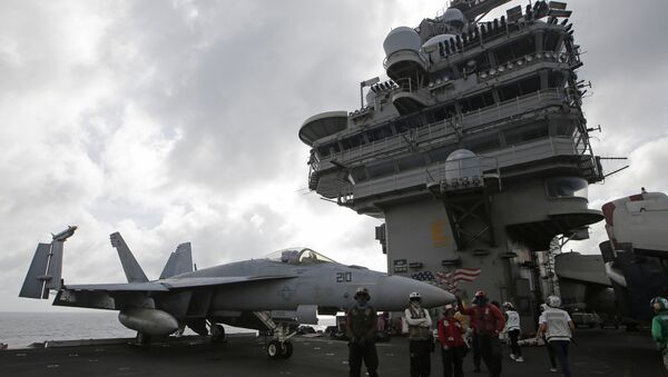 An F/A-18 Super Hornet fighter jet is seen on the deck of the U.S. Navy USS Ronald Reagan in the South China Sea - Sputnik International