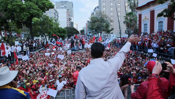 Venezuela's President Nicolas Maduro waves to supporters during a rally in support of the government in Caracas, Venezuela April 6, 2019. - Sputnik International