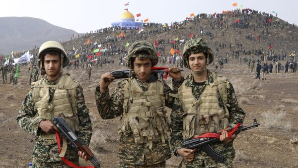 Nov. 20, 2015 photo released by the Fars News Agency, members of the Basij, the paramilitary unit of Iran's Revolutionary Guard, pose for a picture during a military exercise outside the holy city of Qom, central Iran - Sputnik International