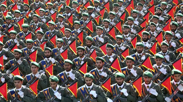 In this Sept. 21, 2016 file photo, Iran's Revolutionary Guard troops march in a military parade marking the 36th anniversary of Iraq's 1980 invasion of Iran, in front of the shrine of late revolutionary founder Ayatollah Khomeini, just outside Tehran, Iran.  - Sputnik International