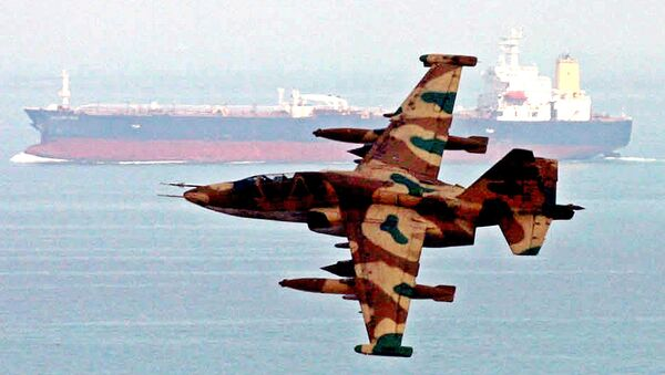 An aircraft of Iran's elite Revolutionary Guards,  flies over an oil tanker during  maneuvers in the Gulf and Sea of Oman, Wednesday, April 5, 2006. - Sputnik International