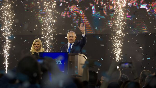 Israel's Prime Minister Benjamin Netanyahu accompanied by his wife Sara waves to his supporters after polls for Israel's general elections closed in Tel Aviv, Israel, Wednesday, April 10, 2019 - Sputnik International