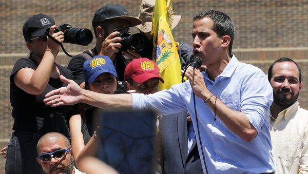 Opposition leader and self-proclaimed interim president Juan Guaido speaks to supporters during a rally to protest outages that left most of the country scrambling for days in the dark in Caracas, Venezuela, Saturday, April 6, 2019 - Sputnik International