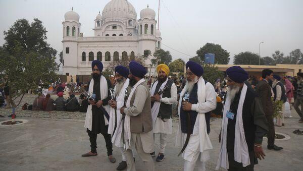 In this Nov. 28, 2018 file photo, Indian Sikh pilgrims visit Gurdwara Darbar Sahib, the shrine of their spiritual leader Guru Nanak Dev in Kartarpur, Pakistan - Sputnik International