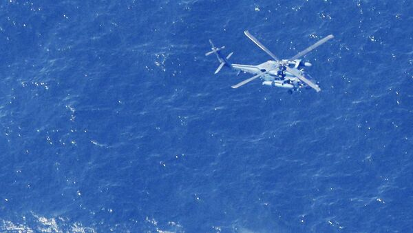 A Japan Air Self-Defense Force helicopter conducts rescue and search operation at the site where an Air Self-Defense Force's F-35A stealth fighter jet crashed during an exercise on April 9, 2019, off Aomori prefecture, Japan, in this photo taken by Kyodo April 10 2019 - Sputnik International