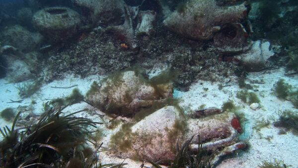 In this photo taken on Sunday, April 7, 2019, ancient amphoras lie at the bottom of the sea from a 5th Century B.C. shipwreck, the first ancient shipwreck to be opened to the public in Greece, including to recreational divers who will be able to visit the wreck itself, near the coast of Peristera, Greece.  - Sputnik International