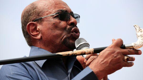 Sudan's President Omar al-Bashir addresses supporters during his visit to the war-torn Darfur region, in Bilal, Darfur, Sudan September 22, 2017 - Sputnik International
