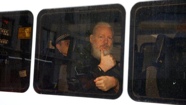 WikiLeaks founder Julian Assange is seen in a police van after was arrested by British police outside the Ecuadorian embassy in London - Sputnik International