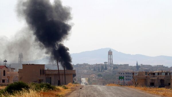 Smoke rises from Taybat al Imam town after rebel fighters from the hardline jihadist Jund al-Aqsa advanced in the town in Hama province, Syria August 31, 2016. (archives) - Sputnik International