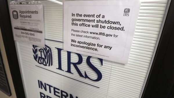Doors at the Internal Revenue Service (IRS) in the Henry M. Jackson Federal Building are locked and covered with blinds as a sign posted advises that the office will be closed during the partial government shutdown - Sputnik International