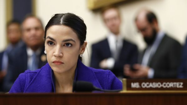 Rep. Alexandria Ocasio-Cortez, D-N.Y., listens during a House Financial Services Committee hearing with leaders of major banks, 10 April 2019, on Capitol Hill in Washington - Sputnik International