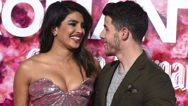 Cast member Priyanka Chopra and her husband, Nick Jonas, arrive at the Los Angeles premiere of Isn't It Romantic at The Theatre at Ace Hotel on Monday, Feb. 11, 2019 - Sputnik International