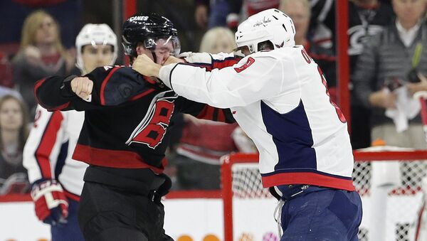 Washington Capitals' Alex Ovechkin, right, of Russia, punches Carolina Hurricanes' Andrei Svechnikov, also of Russia, during the first period of Game 3 of an NHL hockey first-round playoff series in Raleigh, N.C., Monday, April 15, 2019. - Sputnik International