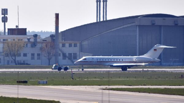 A Global 5000 jet of the government is towed over a taxiway at Schoenefeld Airport in Berlin, on April 16, 2019. After a malfunction shortly after take-off, the aircraft was reversed and landed at Berlin-Schönefeld Airport with major problems - Sputnik International