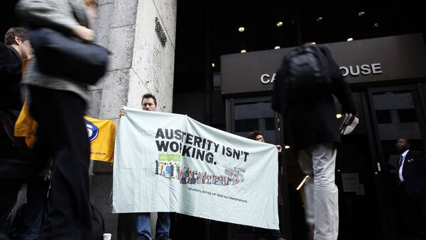 People protesting about the UK government's austerity programme, of which universal credit is the flagship - Sputnik International