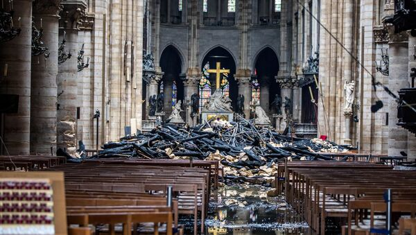 A view of the debris inside Notre-Dame de Paris in the aftermath of a fire that devastated the cathedral, during the visit of French Interior Minister Christophe Castaner (not pictured) in Paris, France, April 16, 2019 - Sputnik International