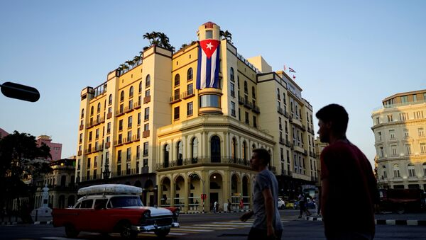 A Cuban flag hangs outside a hotel in Havana, Cuba, April 20, 2018 - Sputnik International