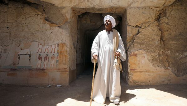 Chief excavation worker Aly Farouk stands outside a newly discovered pharaonic tomb Shedsu Djehuty in Luxor, Egypt April 18, 2019 - Sputnik International
