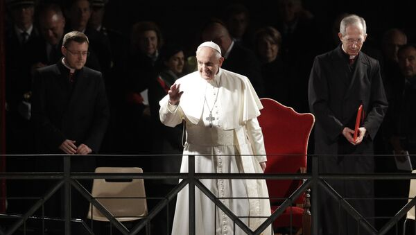 Pope Francis salutes as he arrives during the Via Crucis (Way of the Cross) torchlight procession in front of Rome's Colosseum on Good Friday, a Christian holiday commemorating the crucifixion of Jesus Christ and his death at Calvary, in Rome, Friday, April 19, 2019. - Sputnik International