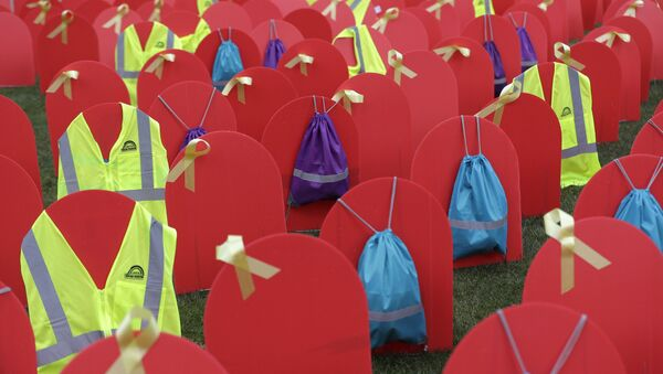 Red mock tombstones designating some of the more than 1,000 people who took their lives by suicide in Washington state in 2017 are displayed on a grassy area near the Legislative Building, Tuesday, March 12, 2019, at the Capitol in Olympia, Wash - Sputnik International