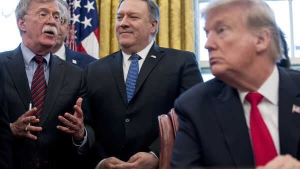 From left, National Security Adviser John Bolton, accompanied by Secretary of State Mike Pompeo, and President Donald Trump - Sputnik International