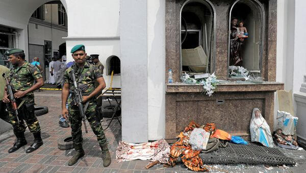Sri Lankan military officials stand guard in front of the St. Anthony's Shrine, Kochchikade church after an explosion in Colombo, Sri Lanka April 21, 2019. - Sputnik International