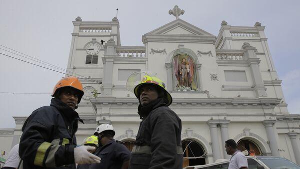 Sri Lankan firefighters stand in the area around St. Anthony's Shrine after a blast in Colombo, Sri Lanka, Sunday, April 21, 2019. - Sputnik International