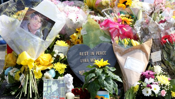 A picture shows the floral tributes placed at the scene in the Creggan area of Derry (Londonderry) in Northern Ireland on April 20, 2019 where journalist Lyra McKee was fatally shot amid rioting on April 18. - Sputnik International