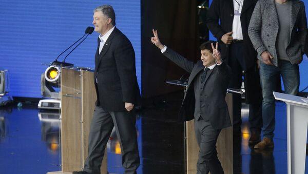 Presidential candidates, Ukrainian President Petro Poroshenko, left, and popular comedian Volodymyr Zelenskiy attend debates in the weekend presidential run-off at the Olympic stadium in Kiev, Ukraine - Sputnik International