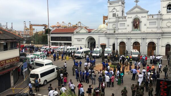Sri Lankan military officials stand guard in front of the St. Anthony's Shrine, Kochchikade church after an explosion in Colombo, Sri Lanka April 21, 2019 - Sputnik International