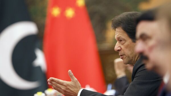 Pakistan's Prime Minister Imran Khan attends talks with Chinese President Xi Jinping (not pictured) at the Great Hall of the People in Beijing, Friday, Nov. 2, 2018 - Sputnik International