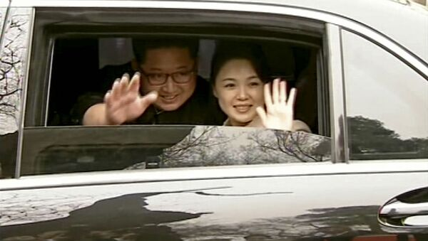 In this image taken from video footage run Wednesday, March 28, 2018, by China's CCTV via AP Video, North Korean leader Kim Jong Un, left, and his wife Ri Sol Ju wave from a car as they bid farewell to Chinese counterpart Xi Jinping and his wife Peng Liyuan in Beijing. - Sputnik International